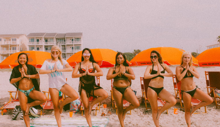 Group of women on beach for bachelorette party
